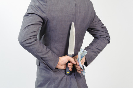 korean man: Man in suit hiding knife and korean won at his back Stock Photo