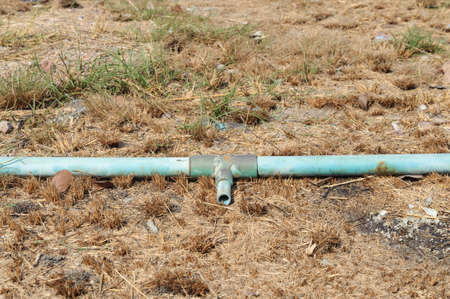 crack pipe: The old crack blue pipe on the dirty burn ground