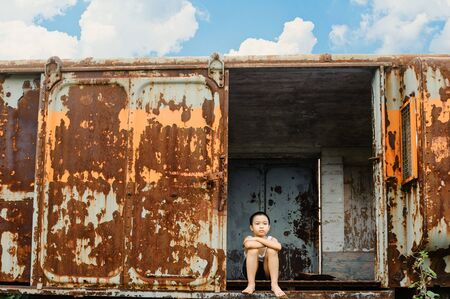 lonely boy: The lonely boy the old train room looking to outside Stock Photo