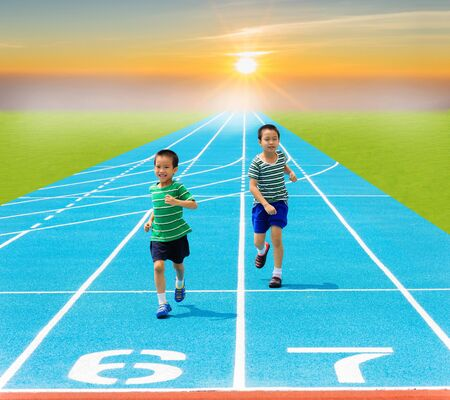 racetrack: Boy running on racetrack in the statium