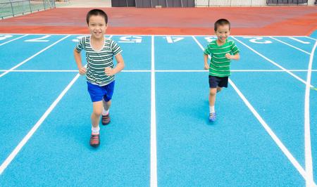 racetrack: Boy running on racetrack in the statdium