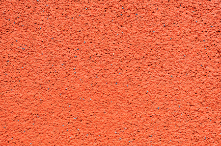 granule: Running track made from red granule rubber background Stock Photo