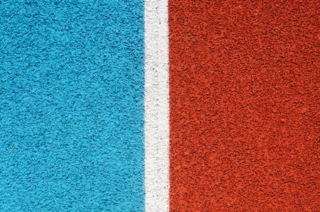 granule: Running track made from red and blue granule rubber split by white line