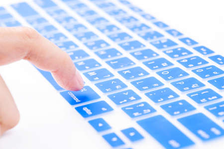command button: Close up woman finger on blue command button Thai keyboard cover