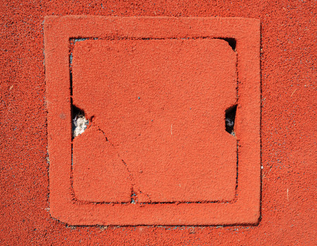 granule: Square Drain water gate on red granule rubber