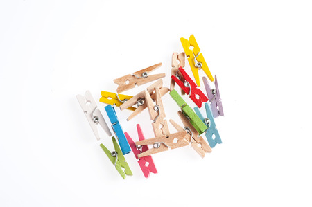 Several color of wood clip on white background photo