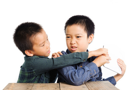 Two boy grab and competition to get tablet device on white background