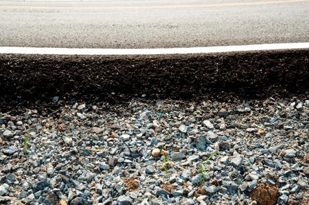 split road: Asphalt road and white line split with stone
