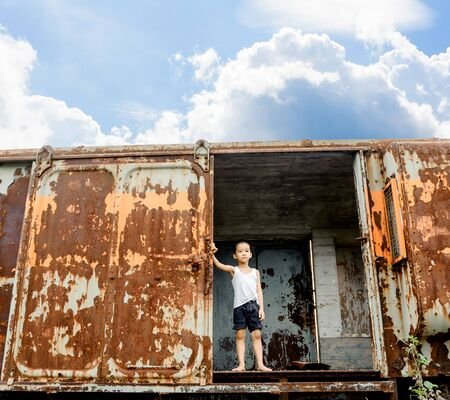 lonely boy: The lonely boy in white vest the old train room looking to outside