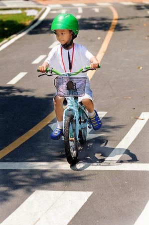 Boy with helmet safty practice biking on the road photo