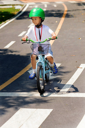 trafic: Boy with helmet safty practice biking on the road
