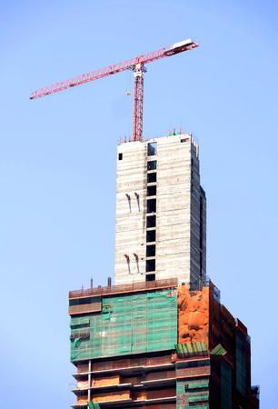 buiding: Construction crane on high buiding site on sky background