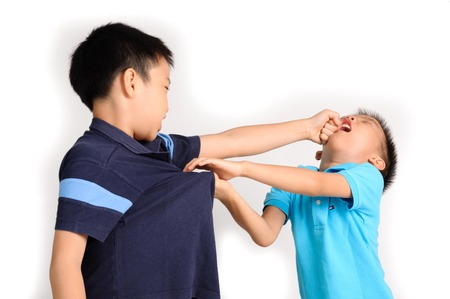 Boys are brother punch and fighting on white background Imagens
