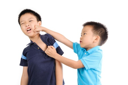 anger kid: Boys are brother punch and fighting on white background Stock Photo