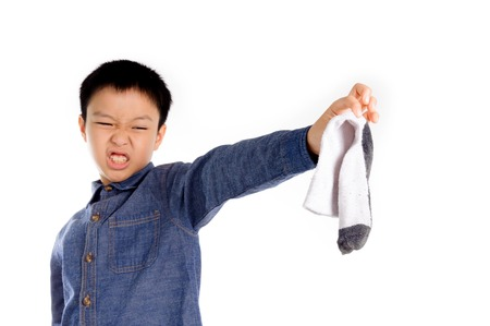 bad feeling: Boy feeling unhappy with bad smell white sock
