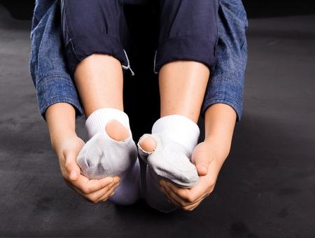 White old sock damage and hole in kind feet 版權商用圖片
