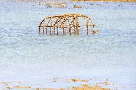 ploy: Fish trap in the sea water Stock Photo