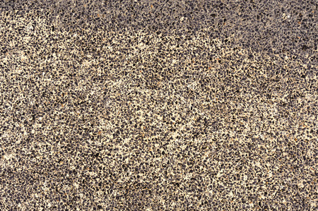 aggregate: The exposed aggregate finish wall made from small stone and sand