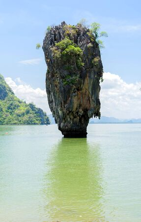 green sea: Rock hill and tree on green sea water in Phuket Thailand