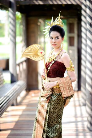 neckless: Portrait young Thai girl in old fashion costume at old Thai wooden house