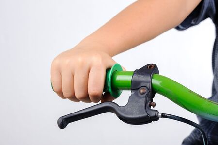 hand brake: Kid hold bicycle hand bar prepare for brake on white background