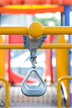 safty: Swinging and climbing metal bar at kids playground