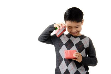 recieve: Young boy open gift box in his hand. Christmas and new year concept.