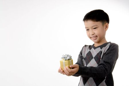 recieve: Young boy carry gift box in his hand. Christmas and new year concept.