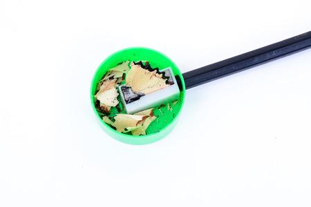 sacapuntas: Verde sacapuntas de lápiz de color sobre fondo blanco Foto de archivo