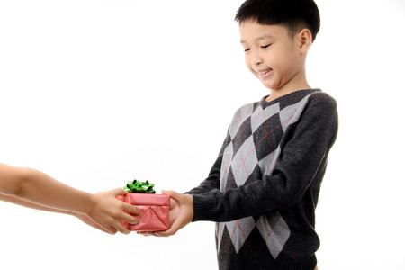 Young boy carry gift box in his hand. Christmas and new year concept.