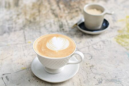 caffee: Vintage color tone. Caffee Latte in white cup on grunge wood table. Selective focus Stock Photo