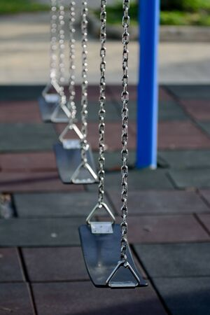 children play: Swing made by leather and iron chain in children play ground