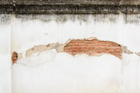 grunge layer: Old brick wall outer layer broken and show grunge red brick. Stock Photo