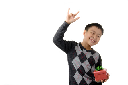 recieve: Young boy carry and feel happy from gift box in his hand. Christmas and new year concept.