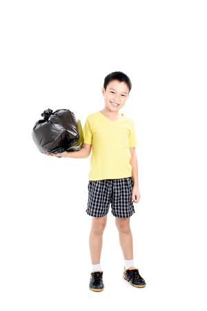 eliminate: Young asian boy carry garbage in plastic bag for eliminate on the white background