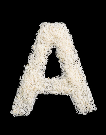 letter: White rice grain alphabet letter isolated on black.