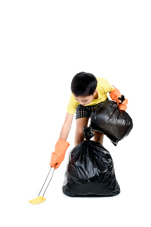 pinch: Young Asian boy use metal pinch to collect garbage in plastic bag for eliminate on the white background