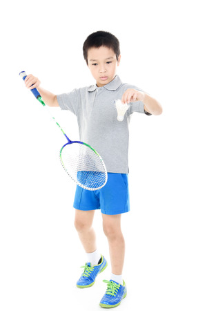 badminton: Young asian boy play badminton on white background