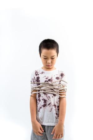 Boy got rope around his body fell unhappy. Stock Photo