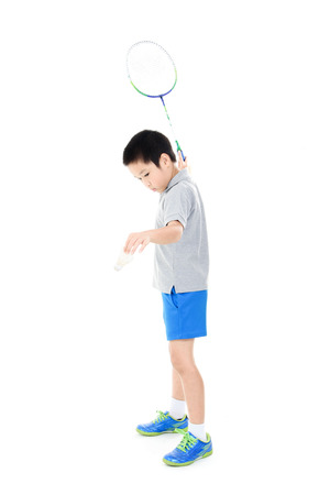 sports and recreation: Young asian boy play badminton on white background