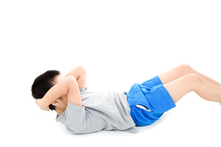 asian abs: Young asian boy workout his abs muscle by sit up on white background