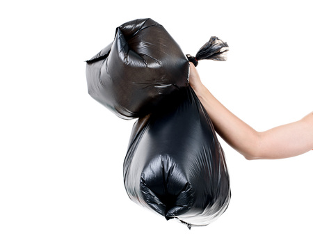 eliminate: Strong man hand carry garbage in plastic bag for eliminate on the white background