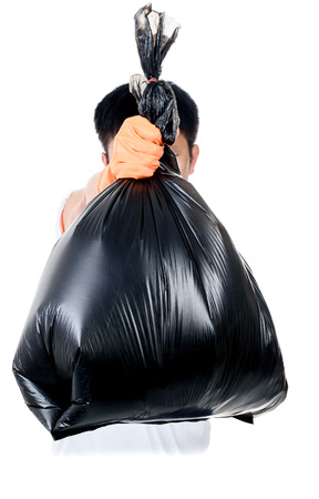eliminate: Strong man hand in orange gloves carry garbage in plastic bag for eliminate on the white background
