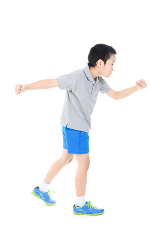 Young asian boy running action on white background