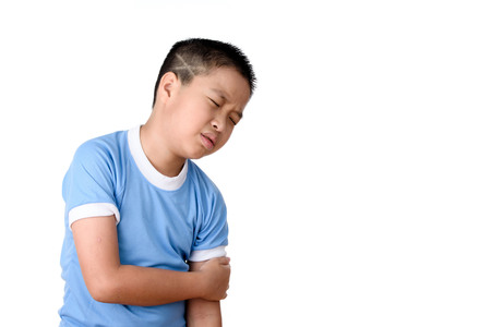 Young asian Thai boy has pain at his arm, isolated on white background.