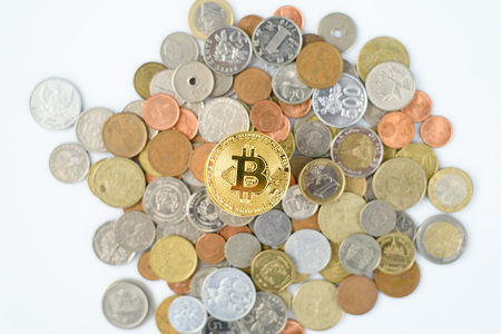 Selective focus at Bitcoin on symbol on top of may currency coin 免版税图像