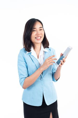 Young business Thai woman use a tablet phone to presentation on white background.