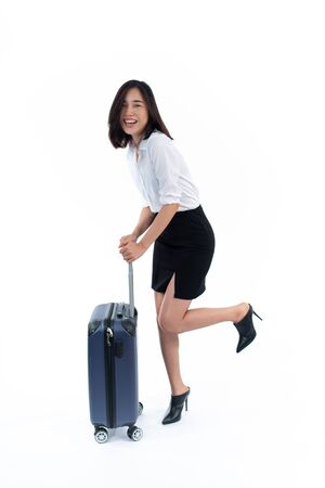 Young business Thai woman walk with a luggage on white background. Business travel concept. Imagens