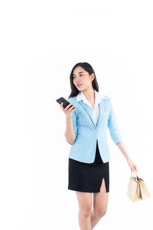 Young Asian Thai woman shopping and talk with mobile phone.