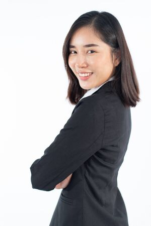 SHooting studio portrait of young Asian Thai woman with formal dress on white background. Relax and mordern concept. Imagens